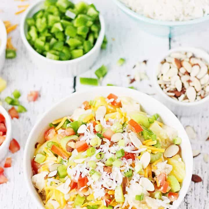 Easy Hawaiian Haystacks -- These easy Hawaiian haystacks area a favorite family meal! A creamy chicken mixture is layered over rice and then topped with a variety of ingredients, from cheese and chopped celery to bell peppers and pineapple.   halfscratched.com