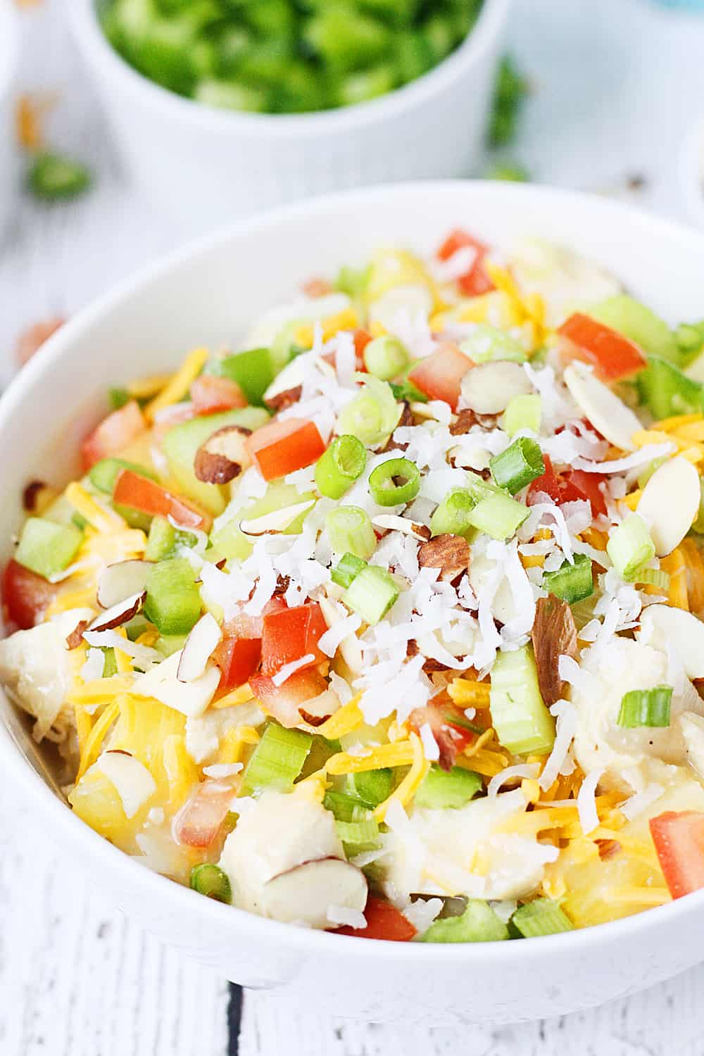 Easy Hawaiian Haystacks -- These easy Hawaiian haystacks area a favorite family meal! A creamy chicken mixture is layered over rice and then topped with a variety of ingredients, from cheese and chopped celery to bell peppers and pineapple. | halfscratched.com