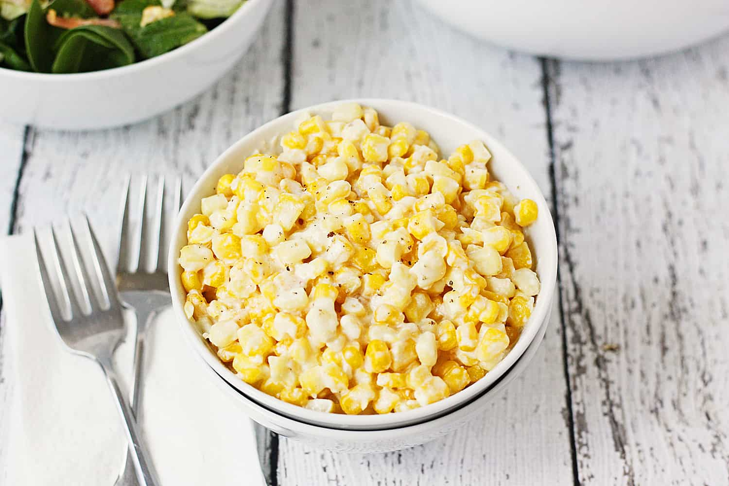Low-Fat Slow Cooker Creamed Corn -- This low-fat slow cooker creamed corn is a lighter version of our family's favorite creamy, corny, extra yummy side dish! | halfscratched #recipe #sidedish #healthyrecipe