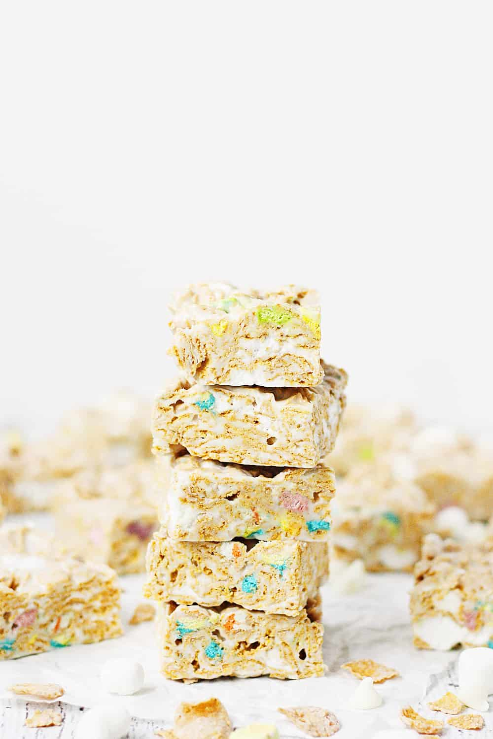 Lucky Charms Frosted Flakes Marshmallow Treats -- You'll think you've died and gone to heaven when you taste these Lucky Charms Frosted Flakes marshmallow treats. They're extra marshmallowy, buttery, and white chocolaty! | halfscratched.com