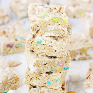 Lucky Charms Frosted Flakes Marshmallow Treats -- You'll think you've died and gone to heaven when you taste these Lucky Charms Frosted Flakes marshmallow treats. They're extra marshmallowy, buttery, and white chocolaty!   halfscratched.com
