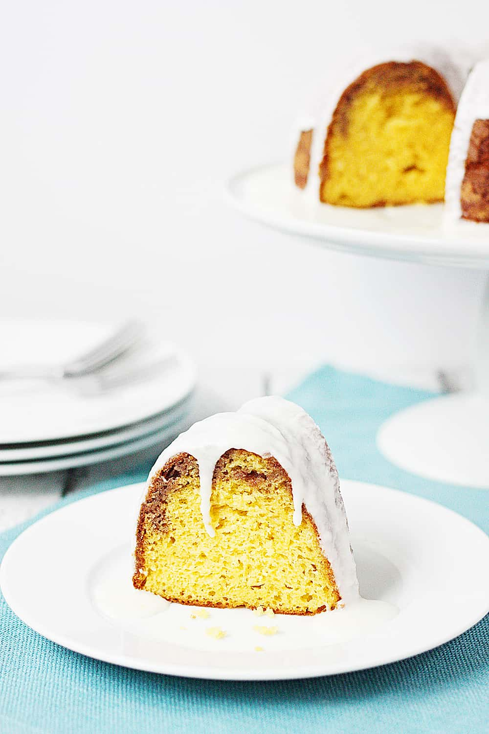 Slice of cake mix coffee cake bundt cake with full cake in the background