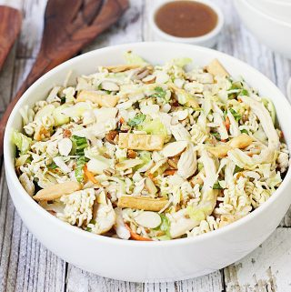 Easy Asian Ramen Salad -- My family LOVES this Asian ramen salad! An Asian salad kit + rotisserie chicken + a few simple ingredients equals the easiest Asian ramen noodle salad ever!
