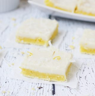 Easy Lemon Bars with a Cake Mix -- Summer celebrations aren't complete without these easy lemon bars! Lemon cake mix, lemon zest, and coconut make this the best lemon bar recipe!