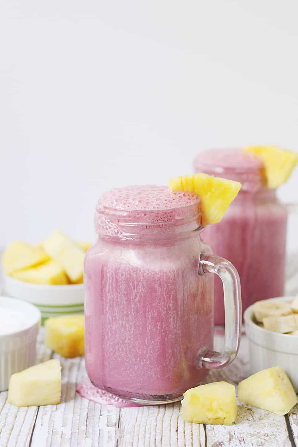 4-Ingredient Pineapple Cranberry Smoothie -- Cranberry lovers will enjoy this 4-ingredient pineapple cranberry smoothie! It features all-natural cranberry juice, frozen pineapple and banana, and Greek yogurt for a tart, good-for-you smoothie! #smoothie #cranberry #whatsyourjuicemadeof @walmart #KnudsenFarmToBottle #pineapple #drink #healthyrecipe #ad