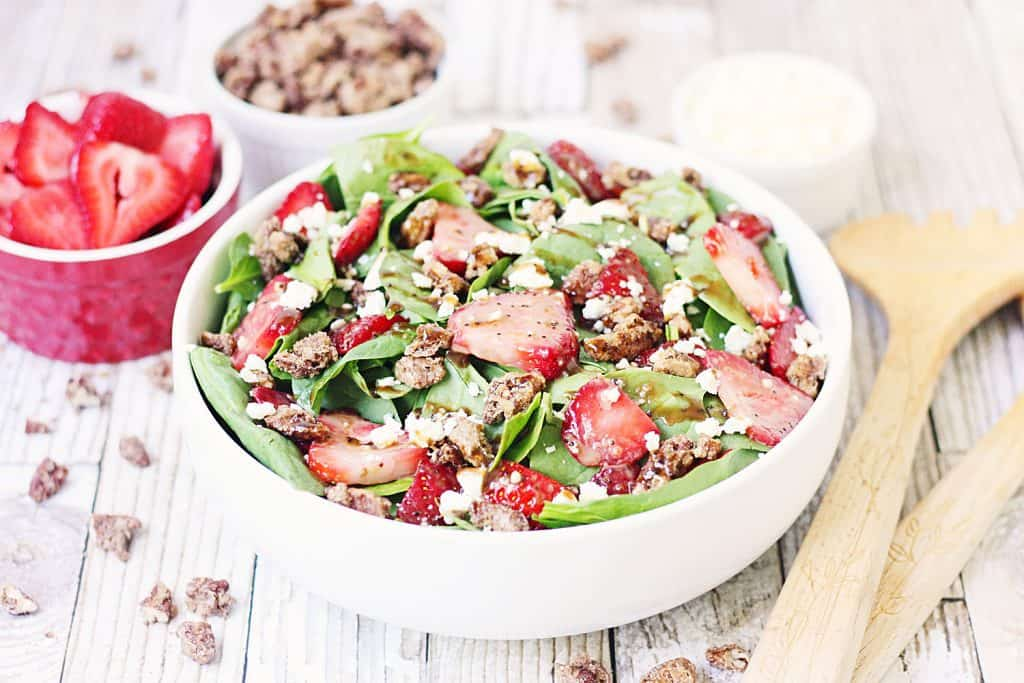 Strawberry Spinach Salad with Balsamic Poppy Seed Dressing -- This strawberry spinach salad boasts baby spinach, fresh strawberries, candied pecans, feta cheese, and the most amazing balsamic poppy seed dressing!