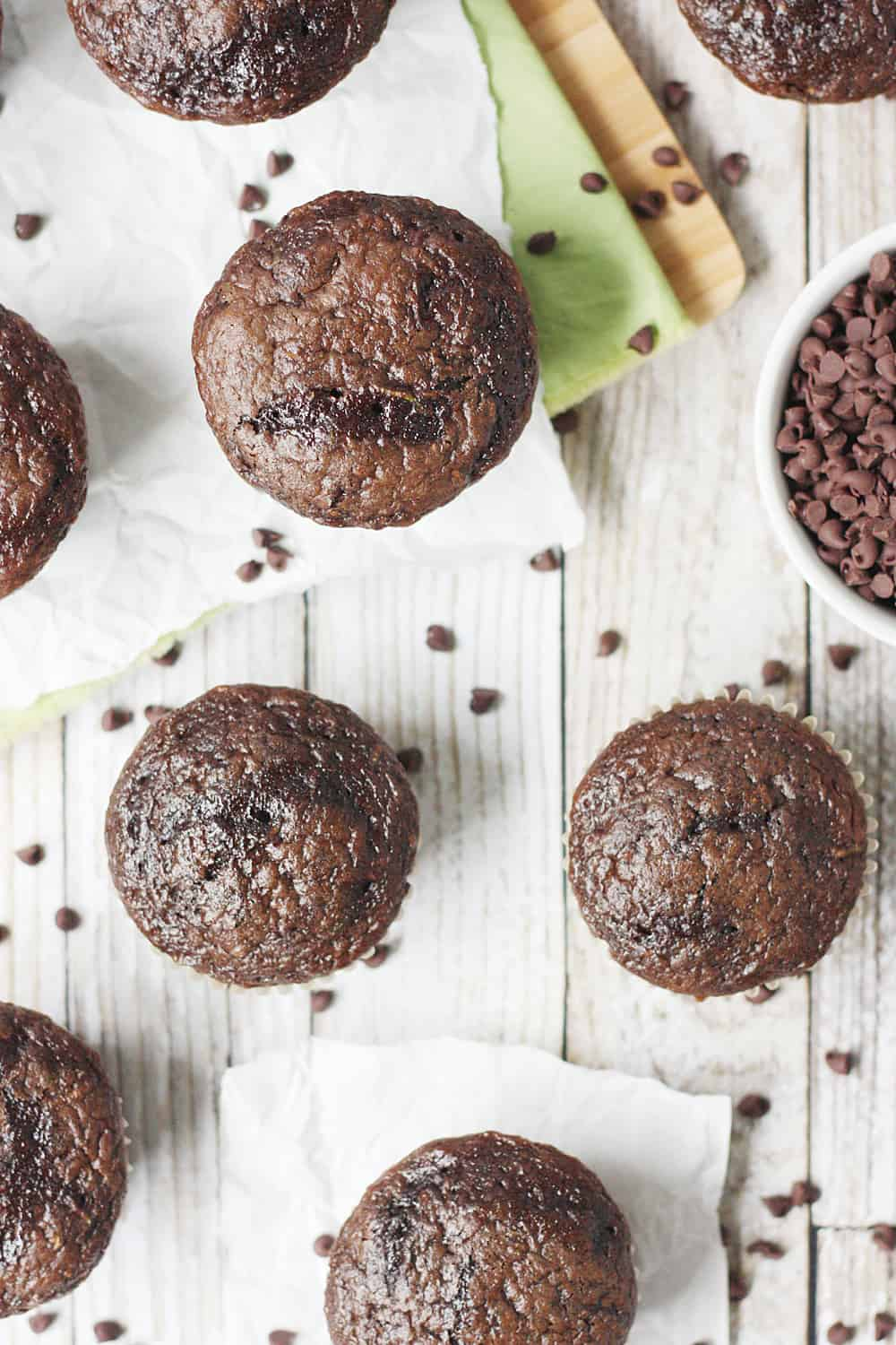 EASY Double Chocolate Zucchini Muffins -- Double chocolate zucchini muffins are easy, moist, and delicious thanks to a decadent chocolate cake mix, mini chocolate chips, and freshly grated zucchini!