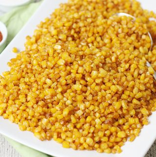 How to Roast Frozen Corn in the Oven -- Roasting frozen corn in the oven is an easy way to prepare a large batch of delicious oven roasted corn for hot dips, salads, and side dishes.