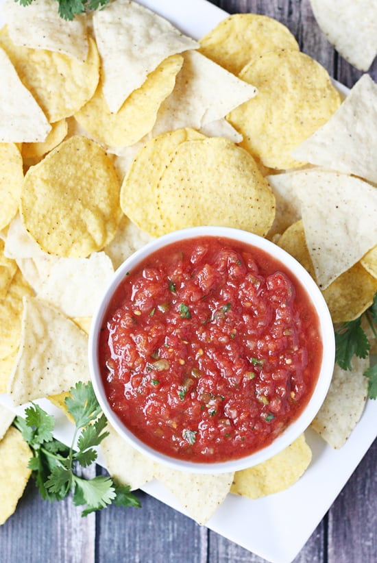 Copycat Chilis Salsa -- After comparing other copycat Chilis salsa recipes and making a few tweaks, this version is by far the closest to the original...and extremely addictive. #salsa #copycatrecipe #copycat #chilis #chilissalsa #appetizer #halfscratched #mexican #mexicanfood