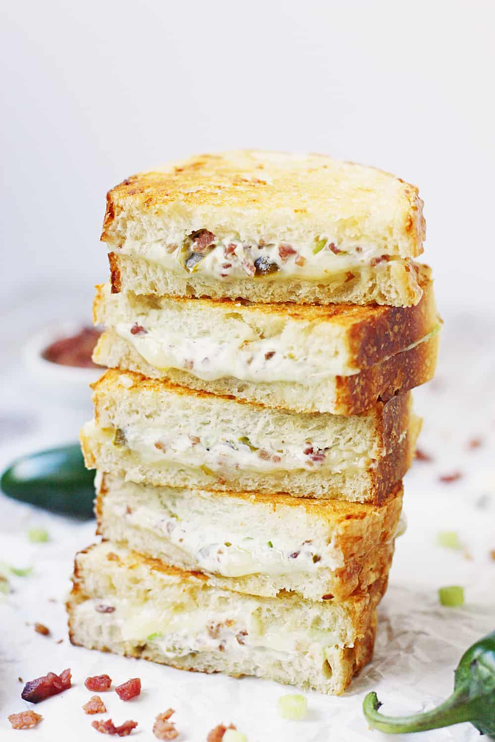 EASY Jalapeno Popper Grilled Cheese Sandwich - This easy jalapeno popper grilled cheese sandwich combines that amazing jalapeno popper flavor with bacon and sharp white cheddar for one irresistible gourmet grilled cheese! #grilledcheese #jalapeno #jalapenopopper #sandwich #grilledcheesesandwich #cheese #easyrecipe #recipe #halfscratched #maindish #savory