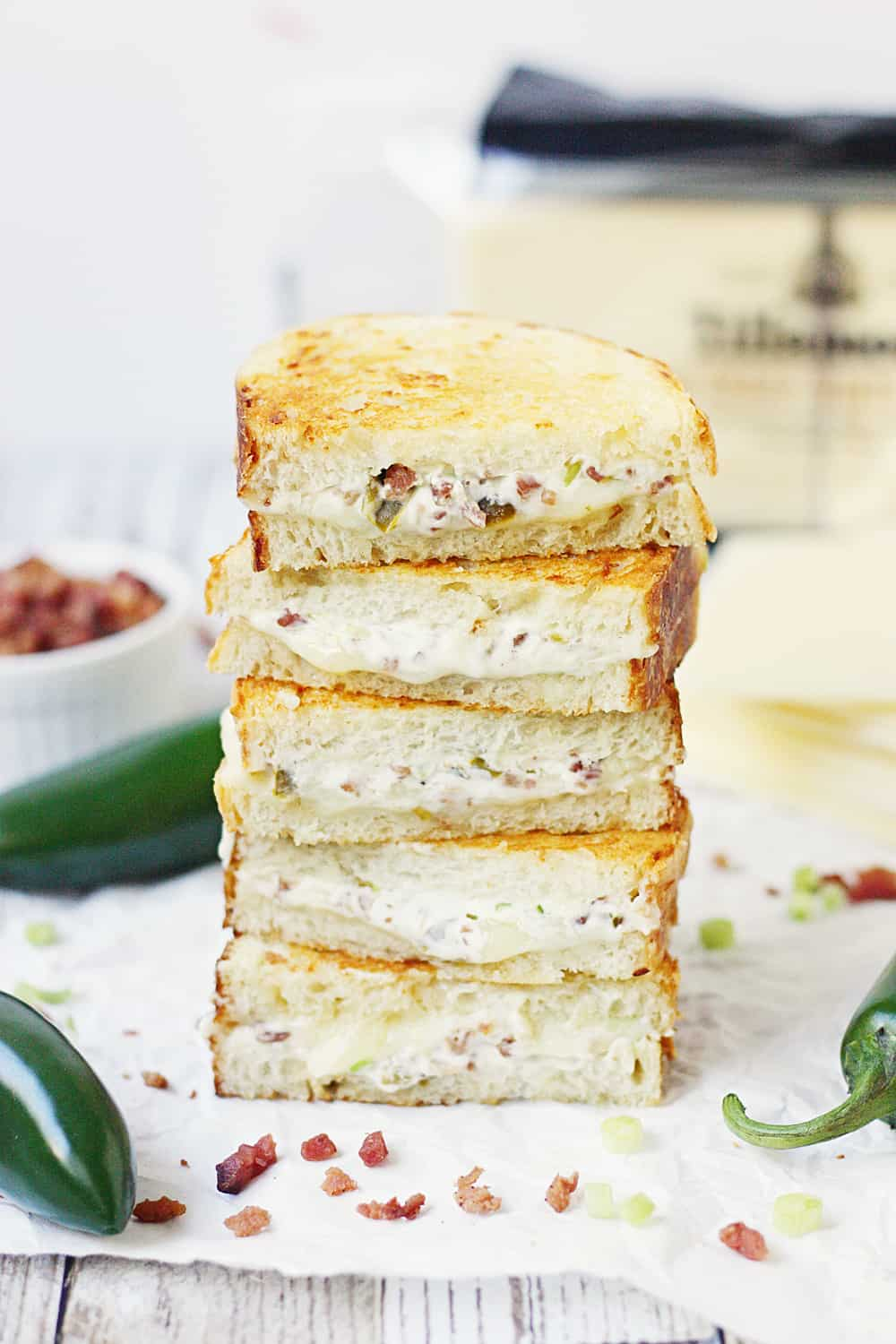 EASY Jalapeno Popper Grilled Cheese Sandwich - This easy jalapeno popper grilled cheese sandwich combines that amazing jalapeño popper flavor with bacon and sharp white cheddar for one irresistible gourmet grilled cheese! #grilledcheese #jalapeno #jalapenopopper #sandwich #grilledcheesesandwich #cheese #easyrecipe #recipe #halfscratched #maindish #savory