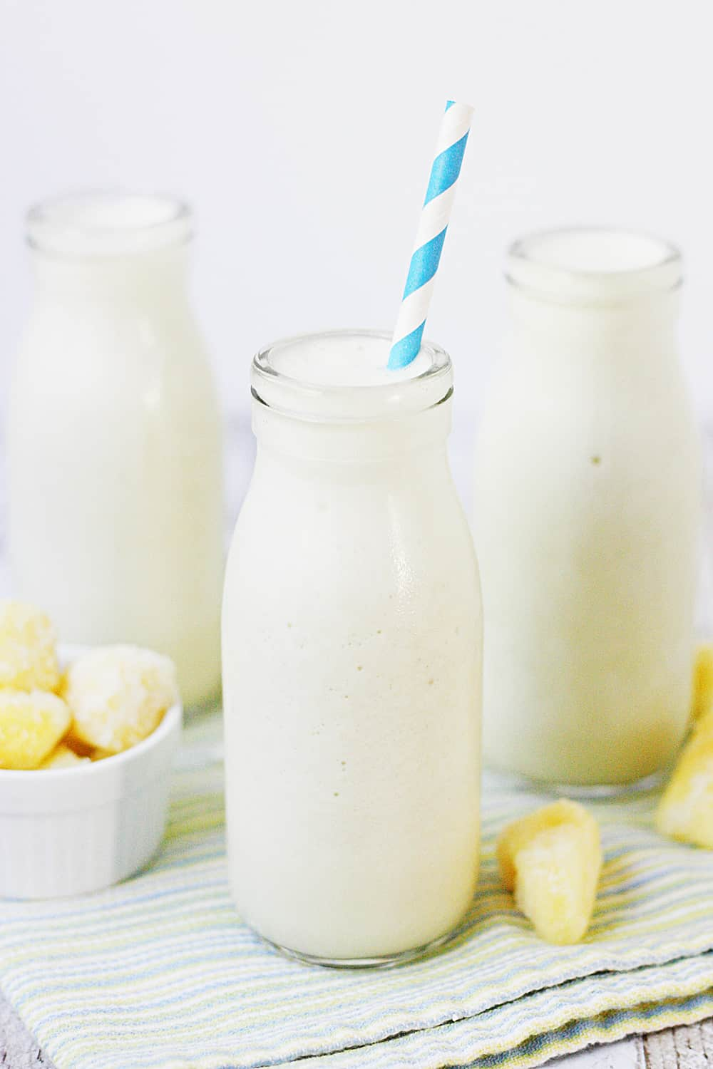 Pina Colada Protein Smoothie - This pina colada protein smoothie is an easy, healthy, delicious, protein-packed way to enjoy your favorite tropical beverage! #halfscratched #pinacolada #smoothie #proteinshake #proteinsmoothie #smoothierecipe #drinkrecipe #drink #healthyrecipe #healthy #pinacoladashake