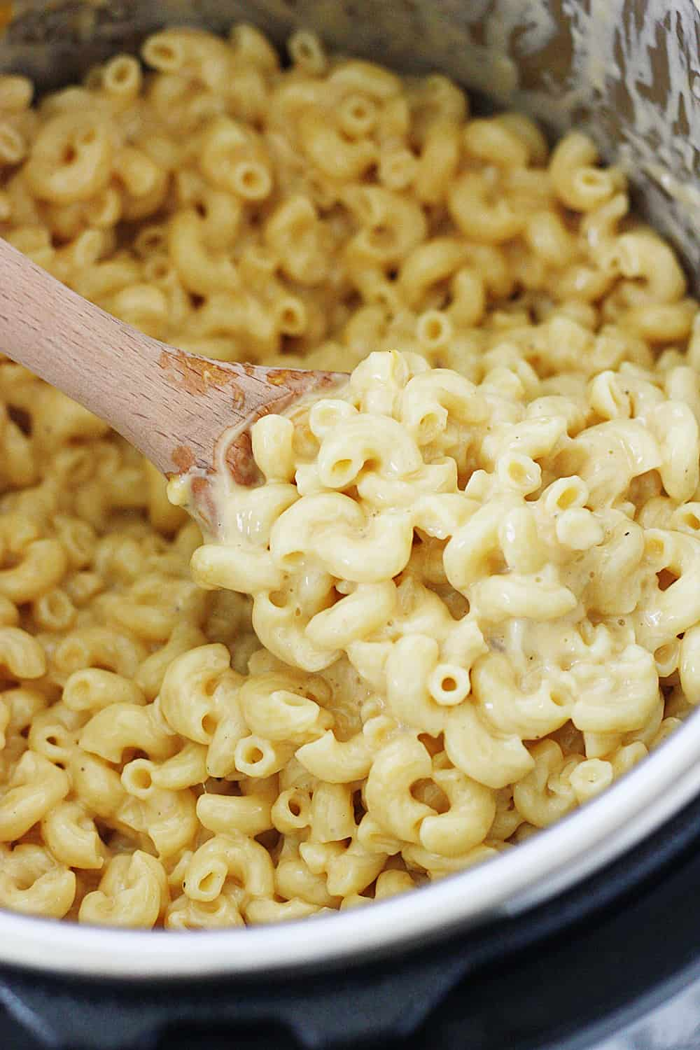 Easy Instant Pot Mac and Cheese - This easy Instant Pot mac and cheese is the creamiest, cheesiest, downright most delicious Instant Pot mac and cheese recipe ever! #macandcheese #instantpot #pressurecooker #macaroniandcheese #pasta #easyrecipe #recipe #cooking #halfscratched #ad #jarlsberg #cheese