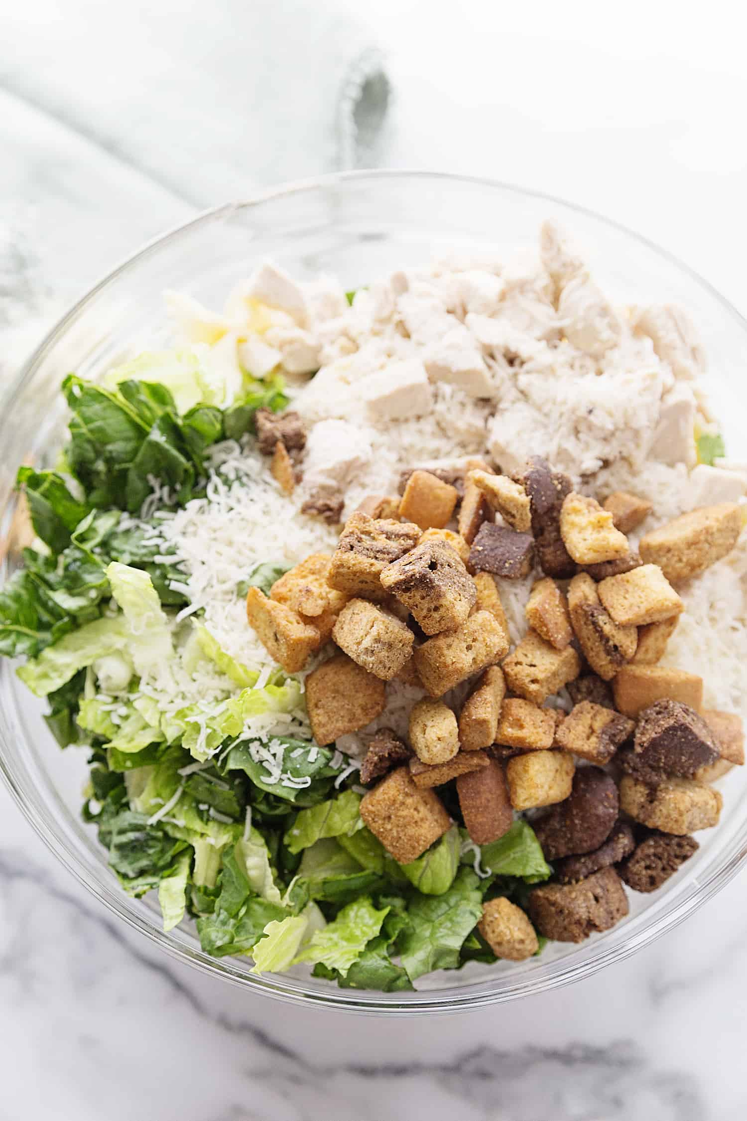 Best Bowtie Chicken Caesar Salad - There's chicken Caesar salad and there's chicken Caesar pasta salad. Once you add bowtie pasta to Caesar salad, you won't want to eat it any other way! #caesarsalad #bowtie #pastasalad #pasta #salad #halfscratched #easyrecipe #sidedish