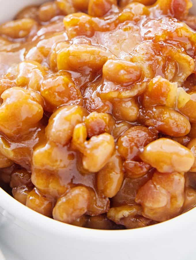 Homemade Baked Beans -- Looking for the best homemade baked beans recipe? This is it! A handful of ingredients plus a half hour in the oven equals the yummiest, most crowd-pleasing baked beans from scratch! #halfscratched #bakedbeans #beans #sidedish #savory #bacon #lentils #easyrecipe
