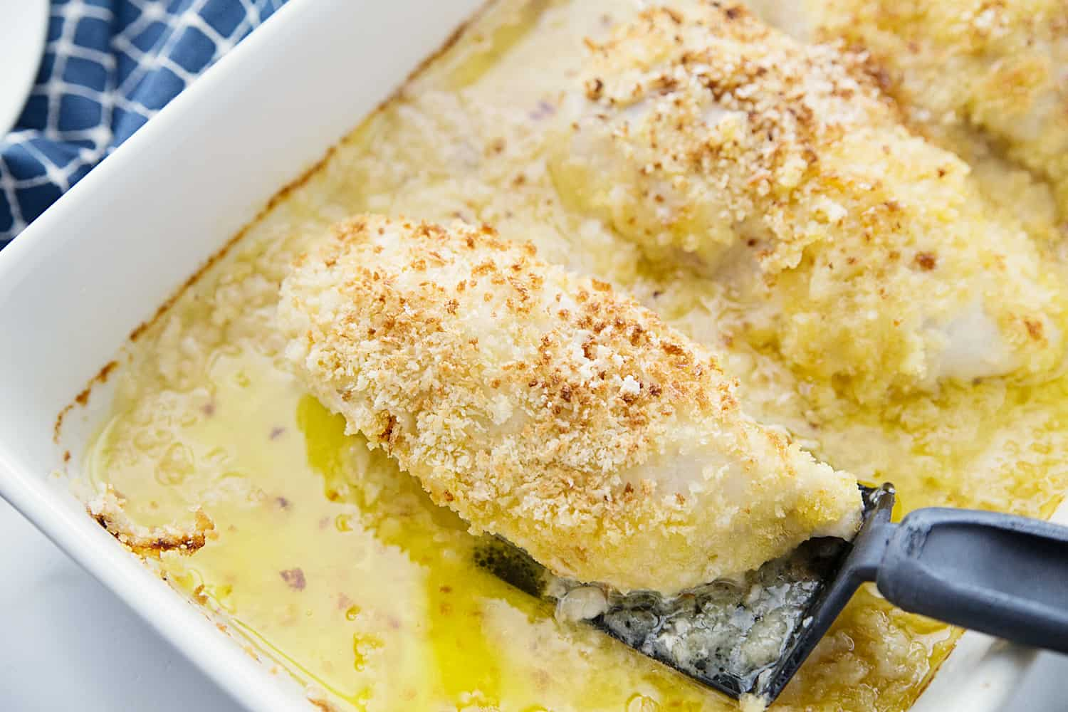 Easy Swiss Cheese Chicken - This Swiss cheese chicken recipe is an easy weeknight meal! Chicken breasts are covered in a creamy sauce and cheese and topped with crispy bread crumbs. #chicken #swisscheese #chickenbake #chickencasserole #halfscratched #chickenrecipe #swisschicken #maindish #easyrecipe #savory