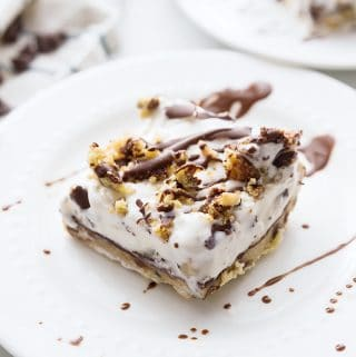 Chocolate Chip Cookie Ice Cream Cake -- Impress guests and taste buds with this chocolate chip cookie ice cream cake. So many layers of scrumptious flavors--what's not to love? #icecream #cookie #icecreamcake #dessert #easydessert #dessertrecipe #chocolatechipcookie #halfscratched #baking