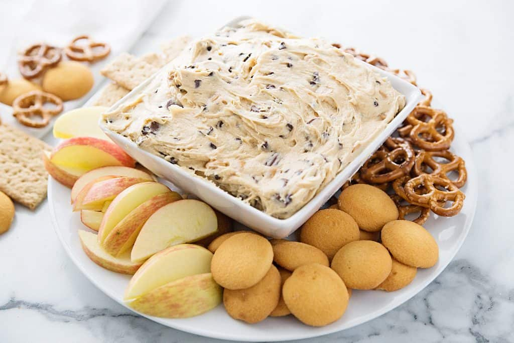 Peanut Butter Cookie Dough Dip - Love it when a dessert doubles as an appetizer! Peanut butter cookie dough dip is a delish flavor combo and will quickly become everyone's favorite! #halfscratched #appetizer #dessert #easyrecipe #cookiedough #cookiedoughdip #peanutbutter #baking #sweet