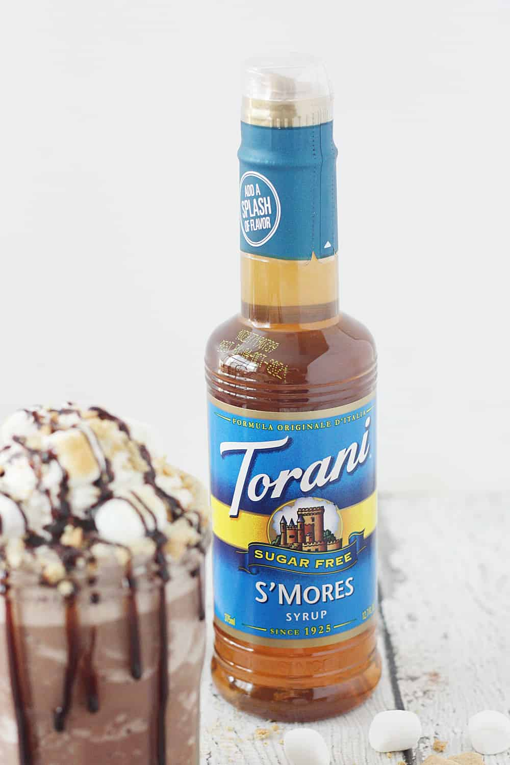 Guilt-Free S'mores Frozen Hot Chocolate - Hot drinks during winter are nice, but sometimes all you want is an icy glass of guilt-free s'mores frozen hot chocolate! #hotchocolate #frozenhotchocolate #torani #aguiltfreeholiday #ad #halfscratched #smores #dessert #drinkrecipe #holidayrecipe