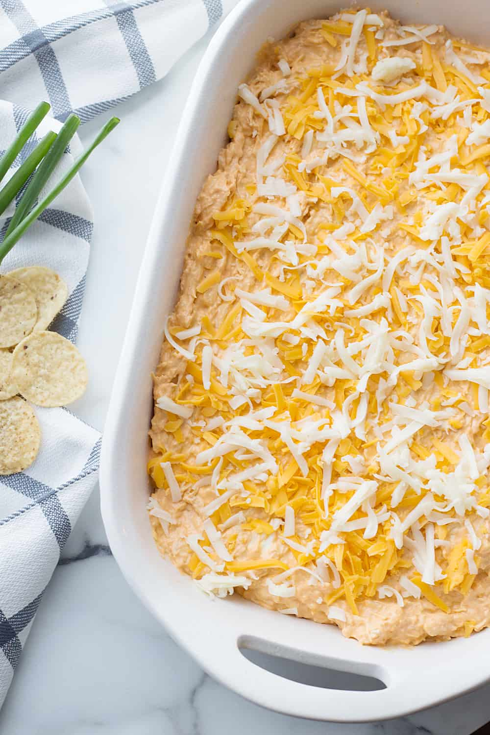 Best Buffalo Chicken Dip - Cheesy, creamy, and all kinds of spicy! There's a reason this buffalo chicken dip is affectionately known as crack chicken dip. #appetizer #buffalo #buffalodip #buffalochicken #recipe #halfscratched #easyrecipe