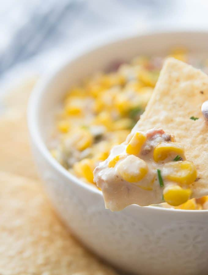 Slow Cooker Cheesy Hot Corn Dip - Looking for a game day appetizer that will have family, friends, and fans cheering? Serve a slow cooker full of this cheesy hot corn dip! #appetizer #slowcooker #crockpot #recipe #corndip #hotcorndip #halfscratched #slowcookerrecipe #crockpotrecipe #appetizerrecipe
