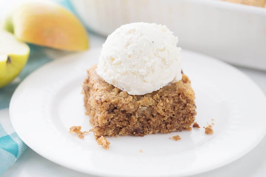 Applesauce Crunch Cake - There's applesauce cake and then there's applesauce CRUNCH cake. Why go for ordinary when you can opt for extraordinary with a crunchy topping? #cake #dessert #applesaucecake #easyrecipe #baking #sweets #easycake #cakerecipe #HalfScratched
