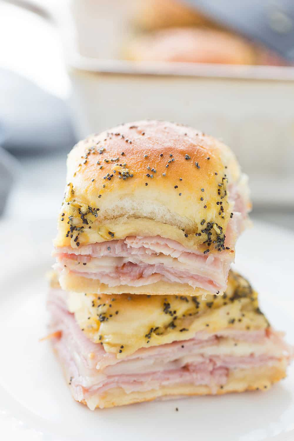 Hawaiian Ham & Cheese Sliders - Need a tasty way to use leftover ham or a recipe that'll feed a crowd? Look no further than Hawaiian ham and cheese sliders! #sliders #leftoverham #easyrecipe #hamandcheesesliders #maindish #baking #partyrecipe #holidayrecipe #halfscratched