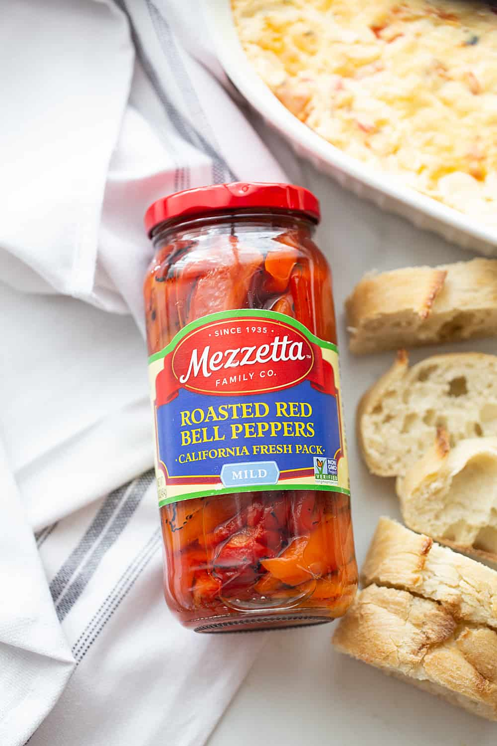Hot Roasted Red Pepper Dip - Planning a summer staycation? #ad Make sure to add some hot roasted red pepper dip to the schedule. In fact, it's so good, you'll want to list it twice! The rich, smoky flavor of @Mezzetta roasted red peppers take this creamy, cheesy, flavorful dip to an entirely new level—a totally tasty, gotta-have-it level! #Mezzetta #halfscratched #hotdip #hotappetizer #appetizer #baking #cooking #vegetarian