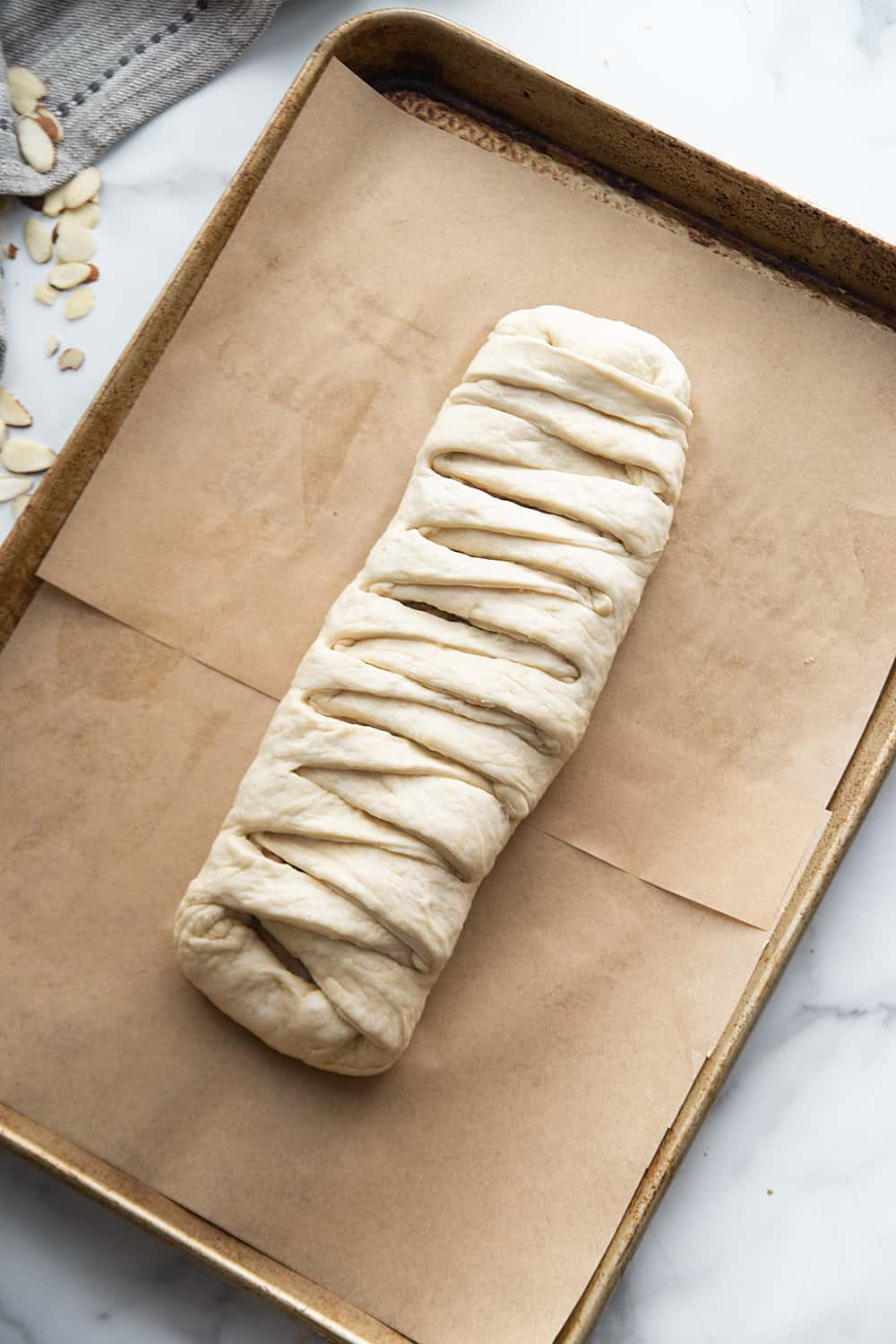 Easy Almond Braid - This easy almond braid is simple *and* totally scrumptious. Good luck not eating the entire beautifully braided dessert in one sitting! #halfscratched #dessert #brunch #almond #almonddessert #baking #almondbraid #braideddessert #recipe #dessertrecipe