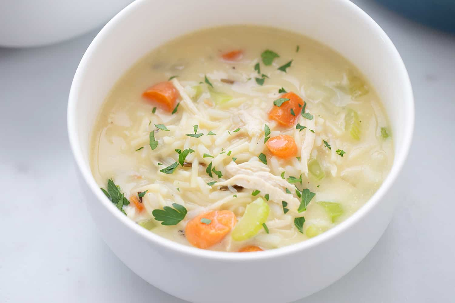 Easy Creamy Chicken Noodle and Rice Soup - Need a comforting weeknight meal that's also quick and easy? Give this creamy chicken noodle and rice soup a try! #soup #chickensoup #chickennoodlesoup #easyrecipe #halfscratched #maindish #easysoup #souprecipe